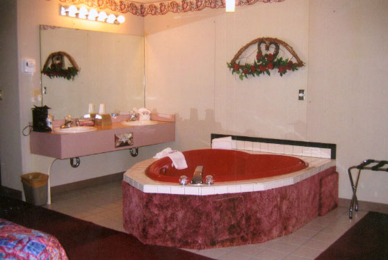 The Honeymoon Suite This Room Features A King Size Bed Love Seat Microwave Coffeemaker And Fridge Hair Dryer Heart Shaped Jacuzzi